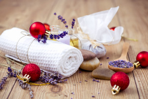 Organic Lavander Products and Christmas Ornaments on Wooden table. Ingredients for Natural Christmas Spa Treatment